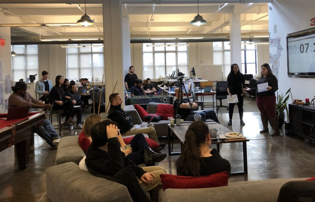 Hackathon teams present to the entire company